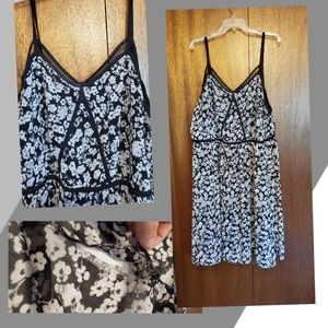 Floral dress, small tear easily fixable
